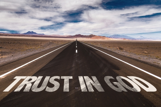 bigstock-Trust-in-God-written-on-desert-98114003.jpg