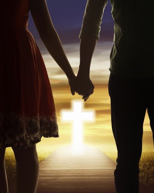 Young Couple Looking The Shining Cross