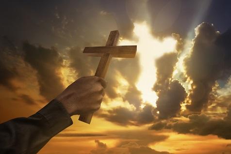 Man Hand Holding Wood Cross Or Religion Symbol Shape