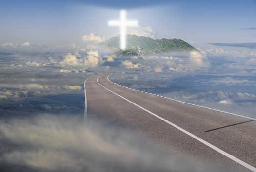 road leading among the clouds,way to a luminous cross