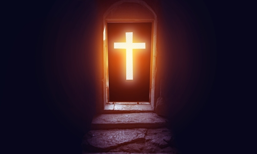 Light Entering Through Cross Door To A Church