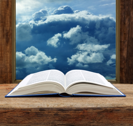 Bible open book wooden window sky view stormy cloud