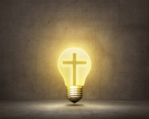 Christian Cross Inside Bright Bulb