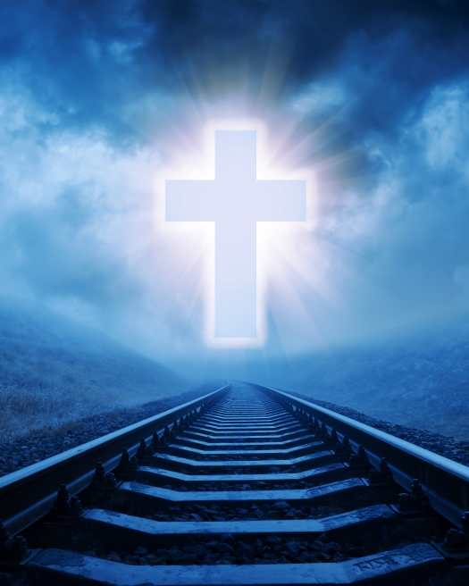 concept of christian cross over railroad in night