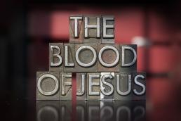 The words The Blood of Jesus written in vintage letterpress type
