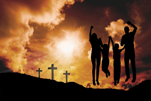 Cheerful family jumping against cross religion symbol shape over