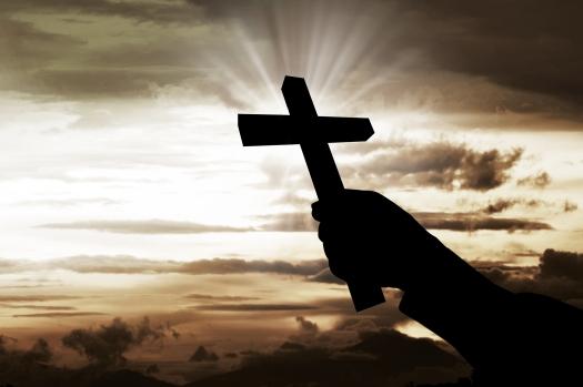 Human Hand Holding Christian Cross