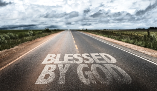 Blessed By God written on rural road
