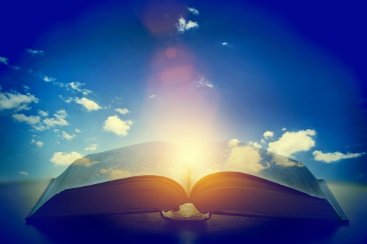 Open old book, light from the sky, heaven. Fantasy, imagination,