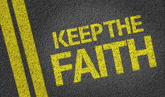 Keep the Faith written on the road