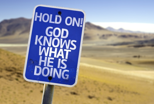 Hold On! God Knows What He is Doing sign with a desert backgroun