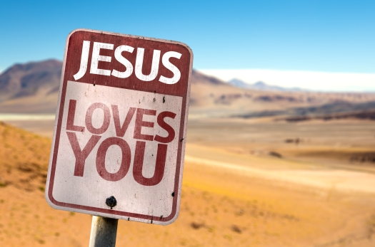 Jesus Loves You sign with a desert background