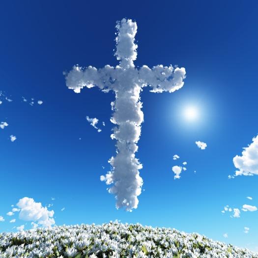 cloudy cross in blue sky