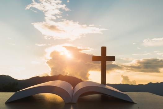 Open Bible, Script In Blur With Focus On Palm Cross,on Sunrise B